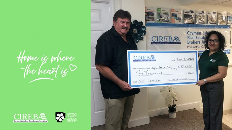Steve Parsons as a CIREBA Board Member presents a check to the Cancer Society for CI$10,000 as part of CIREBA's Home is Where the Heart is charitable donation